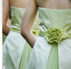 Colleen's five bridesmaids wore tea-length dresses by Alvina Valenta with pleated tulle skirts, each embellished with a fabric flower at the back. Her junior bridesmaid's dress was custom-made to resemble the bridesmaids' looks.