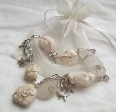Sea Glass Jewelry    Beautiful necklace of sea glass, wrapped stones, sea pottery shard, sea shells, pearls and charms, you don't have to be in a wedding to wear this! The centre wire wrapped sea glass and sea pottery shard pendants could be taken out and worn on its own as well!
