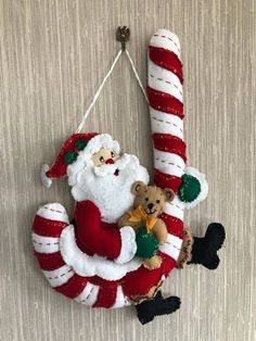 Santa With Candy Cane Felt Wall Hanging Decoration Completed Handmade from Bucilla Kit Christmas Wall Hangings, Felt Christmas Decorations, Xmas Wreaths, Felt Christmas Ornaments, Christmas Balls, Christmas Diy, Holiday Decor, Hanging Decorations, Christmas Stockings
