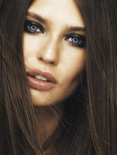 Beauty shot of Bianca Balti in Madame Le Figaro with elegant green and yellow eye makeup.
