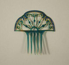 Hair Comb     1920s  Culture:      American or European  Medium:      plastic, glass  Dimensions:      Length: 5 1/4 in. (13.3 cm)