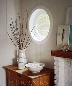 Love all the light that streams in through our new round (porthole) windows at our beach cottage! Living under Oregon's near permanent grey skies, I need to capture all the light I can get :)