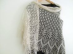 A delicate and romantic hand knitted lace shawl or veil perfect for your wedding day! The semi-circular shawl has been hand knitted using soft and fine lac