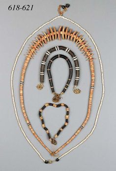 Two Marshall Island Necklace | Each composed of a strand of coconut-shell discs, the first with paired white tridacna-shell discs at intervals; the second with spondylus-shell discs at intervals, each with twisted fibre ties.  AND a Palau Shell Necklace | The long strand of spondylus-shell discs interspersed in four places with coconut and white tridacna-shell beads, the central section strung with large curved oval sections of spondylus-shell