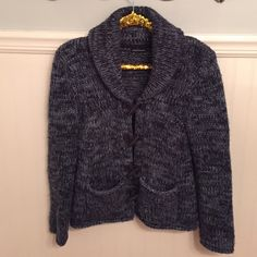 """Moda Intl Toggle Button Cardigan Wool Blend Sz S ▪️ Moda International  ▫️ Shawl collar cardigan w/ toggle buttons.  ▪️ Size Small  ▫️ 80% Acrylic       20% Wool  ▪️ Excellent used condition!   ▫️ Shades of blue. Dark gray toggles.  ▪️ Bust - 17.25"""" across the front, lying flat. Has stretch!   ▫️ Length - 24.5"""" from shoulder to hem.    Bundle to Save 20%!  ❌ No Trades, Holds, PP   100% Authentic!    Suggested User // 700+ Sales // Fast Shipper // Best in Gifts Party Host!  Moda International…"""