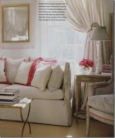 Keeping a small living simple and clean by using cream with a touch of color through accent pillows
