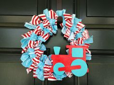 Blue and red train wreath for train birthday party. Great idea to greet guests with at the door.