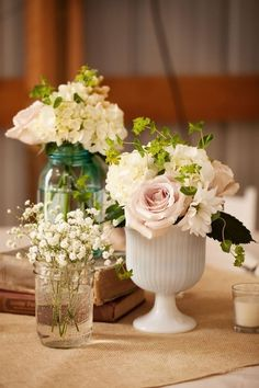 Beautiful table centerpieces. Love the combo of milk glass and simple mason jars. Palest of pink linen tablecloths and use grey burlap or by kaye