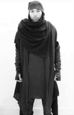 Francois Cristoph. Lamb napa gloves, frayed crushed cotton cardigan, napa trimmed head scarf and longline viscose tunic.