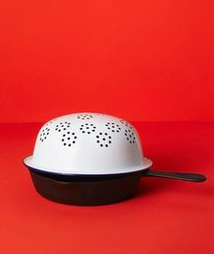 When frying, top the pan with an upside-down metal colander to protect yourself from burns while still allowing heat to escape.