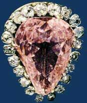 The Grand Conde is one of the most unusual of the world's notable diamonds: a light pink pear-shaped stone of 9.01 carats. Agents of Louis XIII are said to have bought the stone in 1643 after which the King presented it to Louis de Bourbon, Prince of Conde. The diamond remained in the Conde family until the Duc d'Aumale bequeathed it to the French Government in 1892. Today, it is on display in the Musee de Conde in Chantilly, France