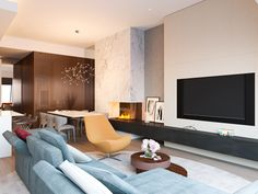 Penthouse in Moscow by Shamsudin Kerimov. Living room with fireplace