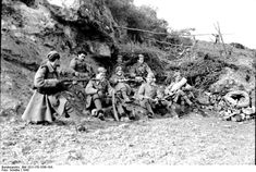 Soldiers of the Greek collaborationist Security Battalions take a break during operations in the countryside to suppress communist resistance fighters. The Security Battalions were responsibility for some of the most heinous atrocities during the Occupation. Very few met just punishment after the war.