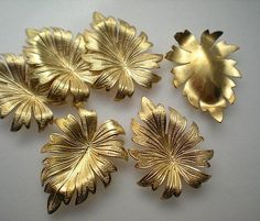 This is a set of 6 raw brass leaf stampings made in the USA. They have shell backs. Photo shows back side of one.Charms measure wide by long.▶▶▶▶▶▶ WANT TO SEE MORE CHARMS? ◀◀◀◀◀◀Check out my shop's supply section with more than 400 items to choose from. Ribbon Embroidery Tutorial, Silk Ribbon Embroidery, Leaf Wall Art, 3d Wall Art, Handmade Wire Jewelry, Copper Art, Golden Leaves, Bracelet Crafts, Diy For Kids
