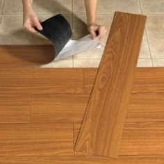 13x18 room for abt $150... great for a mobile home flooring....   PROPERTY BROTHERS TV SHOW IS WHERE I FIRST SAW THIS USED. USED OFTEN. VINYL WOOD LOOK, AS YOU CAN JUST STICK IT DOWN ON CLEAN, NO NAIL UP SURFACE. I HAVE SEEN THIS USED ON TV AN IT IS SAID TO BE VERY DURABLE.