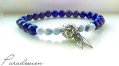 Lapis Lazuli Bead Bracelet with Lion charm and dual feathers