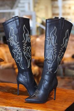 """- Black Faux Leather Boots - Retro Toe Stitch - 4 1/2"""" Stiletto Heel - 10"""" Zipper on inside bottom of leg from calf to sole for ease of dressing/ accessing pants with gold zipper pull. - Pull Tab Tops"""
