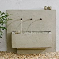 Like this concrete, modern style with short spigots.  Don't like the way the basin floats above ground level.