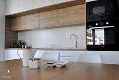Mieszkanie Kraków,50m2. Realizacja - Mała kuchnia jednorzędowa, styl nowoczesny - zdjęcie od Architekt wnętrz Klaudia Pniak