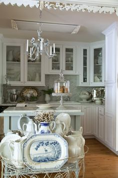 Creative Kitchens...Cottage Journal...love the dishes in the wire planter...