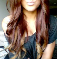 Brown/red hair with caramel blonde highlights.