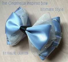 The Cinderella Inspired Bow Collection is inspired by Disneys Princess Cinderella. Each bow is made by hand with precision and care. I will add ribbons tails to bows upon request at no extra charge. Please keep in mind that all sizes do vary in design but stick to the same character theme. The Mini Bow is 3 inches in width and consists of two bow layers. The Original Bow is 4 inches in width and consists of two bow layers as well but it is about twice the size of the Mini style bow. The…