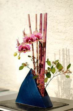 Simple and, again, a nice idea for a table centerpiece - would be pretty with green bamboo and an orange vase