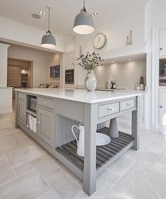 timeless custom cabinetry ———————————————————————— As designers and cabinetmakers specializing in furniture-style cabinetry we are wanting to introduce our followers not only to our work but the work of other exemplary cabinetmakers. .  Today we're featuring a beautiful grey kitchen island with a beaded inset frame by @tomhowleykitchens , a UK based bespoke cabinet company. .  Find more inspiration visit www.wesleyellen.ca . . . . . #timeless #traditional #kitchendesign #kitchengoals…