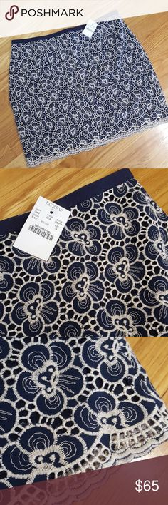 NWT J. Crew Navy Embroidered Skirt NWT J. Crew. Navy & cream embroidered skirt with navy liner. Beautiful scalloped border. Midi length. Size 14. J. Crew Skirts Midi
