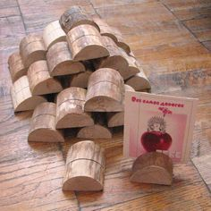 25 Birch Wood Holders for displaying photos, postcards, business cards and more.... $25.25, via Etsy.