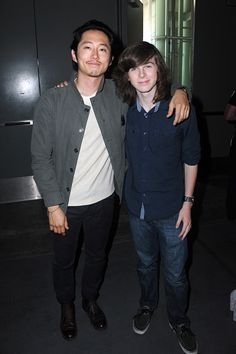 Steven Yeun and Chandler Riggs attend AMC's 'The Walking Dead' panel during Comic-Con International 2016 at San Diego Convention Center on July 22, 2016 in San Diego, California.