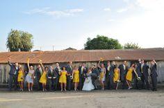 Yellow bridesmaids dresses & grey suits.