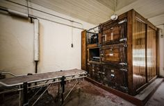 "Willard Asylum - Willard, New York Taken from site;'The ""fridge"" storage was notoriously problematic. Quite often the custodian there would have to work on the compressor which was located in the back. The only way to get to the back was to climb through the #2 body tray.' Click through for more on this Asylum, well worth a read."