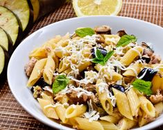 Tuna Pasta Salad with Eggplant and Mint served warm, garnished with mint leaves and a sprinkling of Parmesan, makes a delicious light summer lunch or supper. Penne Pasta Salads, Tuna Salad Pasta, Mint Recipes, Healthy Recipes, Eggplant Pasta, Plats Healthy, Antipasto, Macaroni And Cheese, Side Dishes