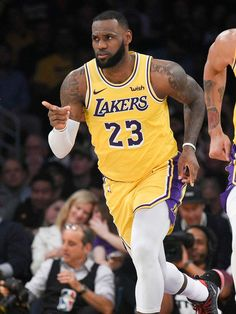 e10394a06 Kobe Bryant s presence inspires LeBron James in Lakers  first home win Lebron  James Lakers