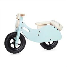 Wooden Vespa Style Scooter - Blue  Your kid will ride in style with the Blue Wooden Vespa Scooter, exclusive to Indigo! This balance bike is a redesigned classic toy with a cool retro European feel. It also has nice little details your child would appreciate like a pleather seat, and a rear storage unit to carry the essentials on-the-go. Sturdy wheels, wood materials and construction ensures lasting play value. Adult assembly required. - read less  List Price	$99.95  In Stock    Variations: