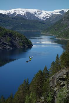 Amazing new zip lines near Trolltunga, Hardangerfjord, Norway. Trolltunga zip lines are probably among the most spectaclar in the world.  Lake Ringedalsvatnet and Folgefonna glacier in the background. www.opplevodda.com