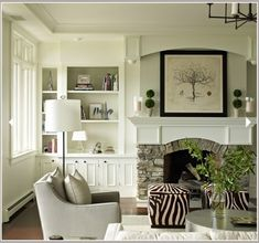 Stone fireplace, built-in bookcase and arched wood mantel. by jayne