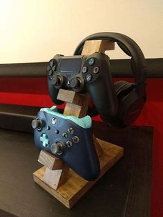 This controller and headphone stand is uniquely handmade! They make great gifts for any occasion. 1 controller stand is Wide, inches. Depth 2 controller stand is Wide, in. Depth 3 controller stand is wide, Diy Headphone Stand, Wood Projects, Woodworking Projects, Woodworking Machinery, Woodworking Tools, Diy Headphones, Gaming Room Setup, Computer Gaming Room, Gamer Setup