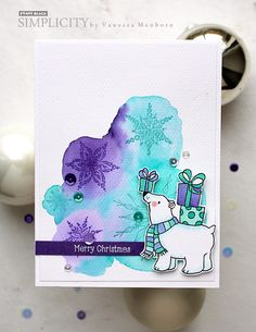 A unique color scheme, an adorable bear, and a lovely watercolored background make Simplicity Sister, Vanessa Menhorn's, card a stand-out. And by stamping snowflakes from our transparent set,…