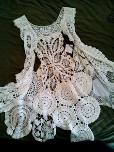 Old doilies pieced together into a vest. So delicate and still modern, with the asymmetrical design. Made by Marijo Brown with her Home Chic Home collection.