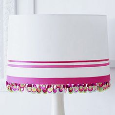 Ribbon Stripes and Beaded Trim  Create a glamorous lampshade by gluing or pinning ribbon lengths around the shade. For a little extra pizzazz, glue beaded trim around the bottom of the shade so it will glisten when the light is on.