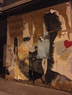Partially torn down street art on Valencia at 19th