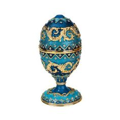 The Dowager Faberge-Style Enameled Egg in Royal Blue by Design Toscano. $49.95. Hand jeweled. Lost wax casting. Hand enameled. FH15772 Features: -Faberge style.-Artist: Carl Faberge.-Hand enameled and hand faux jeweled. Construction: -Constructed of metal alloy using lost wax method. Color/Finish: -Royal blue finish.