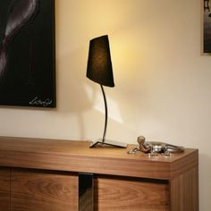Black table/desk lamp - ultra modern.  A truly stunning item with ultra modern chrome base and elegant shaped black fabric shade.  Made by Europe's top lighting manufacturer, please do not confuse with cheap Asian copies.  Matching floor lamp also available.