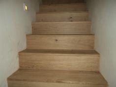 betonnen trap bekleed met eik door heylen & Co samen met carvers Mieke