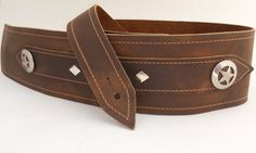 A personal favorite from my Etsy shop https://www.etsy.com/listing/130136638/tricked-out-leather-brown-w-silver-star