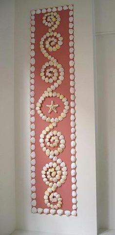 Paint a panel on a wall and decorate with shells! You can also do this on a board if you don't want the decor to be permanent!
