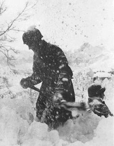 Two men of the 7 Fallschirmjäger Division in October 1942 spending another harsh winter on the Eastern Front. Seen here digging a defensive position.
