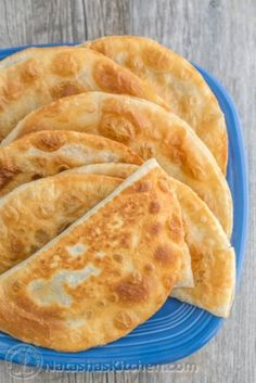 Chebureki are a type of savory turnover. Using raw tortillas, cuts your prep time in half! These are definitely a crowd pleaser. Ukrainian Recipes, Russian Recipes, Ukrainian Food, Calzone, Slovenian Food, Eastern European Recipes, Turnover Recipes, Tortilla Recipe, Raw Tortillas Recipe